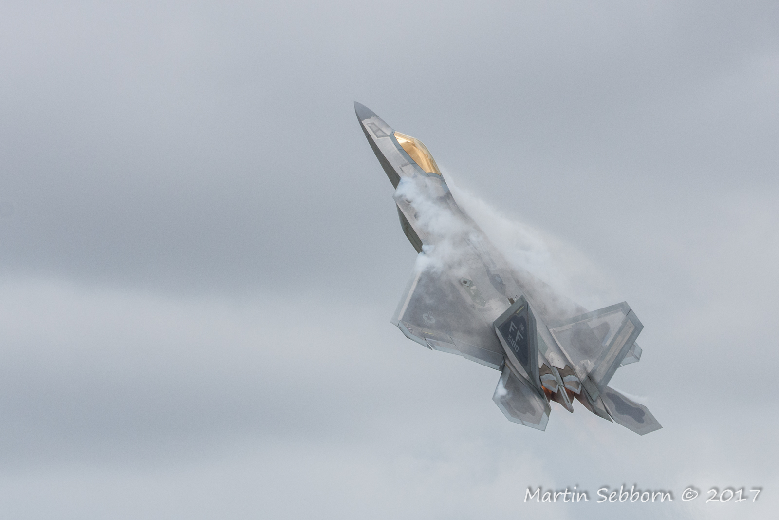 "F-22 ""Raptor"" creating some mist!"