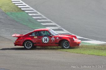 A Porsche doing what they do best - spinning off!